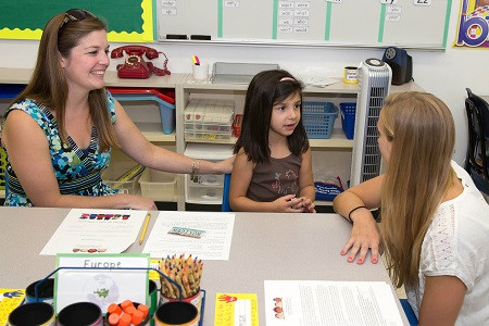 HANSCOM AIR FORCE BASE, Mass. – Jennifer Carrion and her daughter 6-year old Madison meet with first grade teacher Rachael Peterson during a meet and greet at the primary school here Aug. 28. Children and parents were invited to come and meet their new teachers and visit the classroom that the children will be in for the upcoming school year. (U.S. Air Force photo by Mark Herlihy)